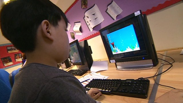 Boy learning to programme computers