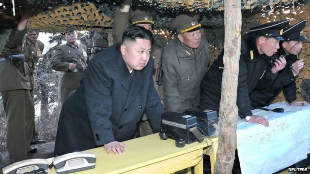 North Korean leader Kim Jong-Un watches soldiers taking part in anti-landing drills