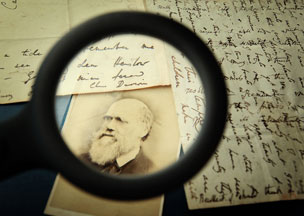 Magnifying glass on picture of Charles Darwin