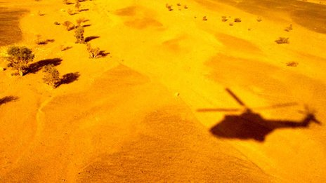 Shadow of a helicopter in the desert