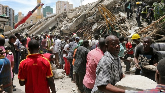 Rescue workers remove debris at the site of a building collapse in Tanzania