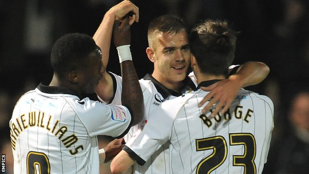Tom Pope celebrates scoring for Port Vale