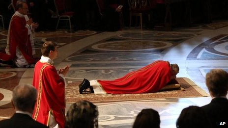 Pope Francis lies down in prayer during the Passion of Christ Mass at St Peter's Basilica, at the Vatican, 29 March 2013