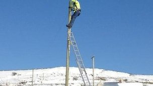 BT engineer up pole