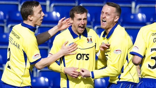 Kilmarnock star James Fowler (centre) celebrates his early goal with fellow team-mate's Jereon Tesselaar (left) and Sammy Clingan.