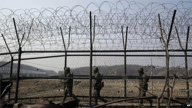 South Korean army soldiers patrol along a barbed-wire fence at the Imjingak Pavilion near the border village of Panmunjom on 15 March 2013