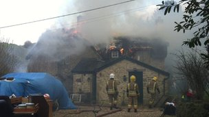Thatched roof fire
