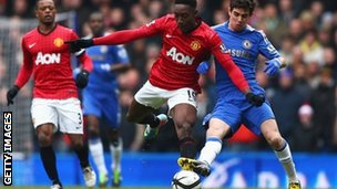 Manchester United's Danny Welbeck (second left) is tackled by Oscar of Chelsea