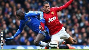 Chelsea's Demba Ba (left) tussles with Manchester United's Chris Smalling