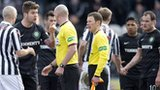 Referee Bobby Madden speaks to players following St Mirren's draw with Celtic