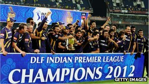 Kolkata Knight Riders cricketers, support staffs and officials celebrate with the DLF IPL 2012 trophy