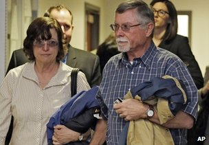 Robert and Arlene Holmes arrive at district court for a hearing 