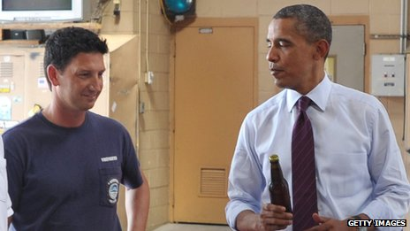 Barack Obama presents White House ale to firefighters