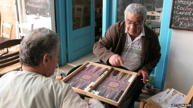 Cypriots play backgammon outside a cafe in the old city of Nicosia