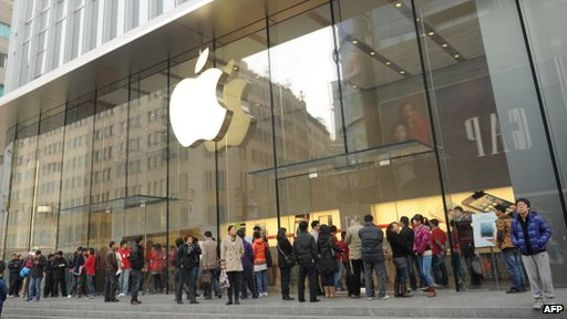 Customers outside an Apple store in China