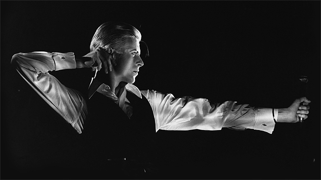 David Bowie: The Archer. Station to Station tour, 1976. Photograph and © John Robert Rowlands