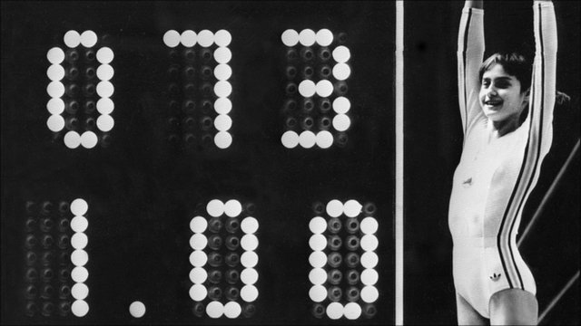 Nadia Comaneci celebrates as the scoreboard shows the perfect score of 10