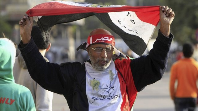 A protester opposing Egyptian President Mohamed Mursi's rule waves an Egyptian flag