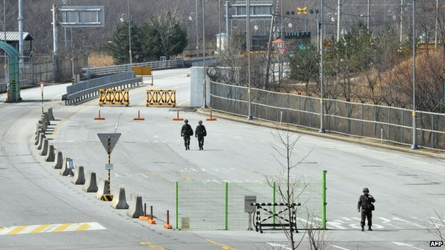 South Korean soldiers stand on the empty road