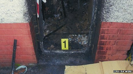 The charred front door at the house at Victory Road