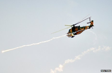 A Syrian attack helicopter fires a rocket on exercises (file image)
