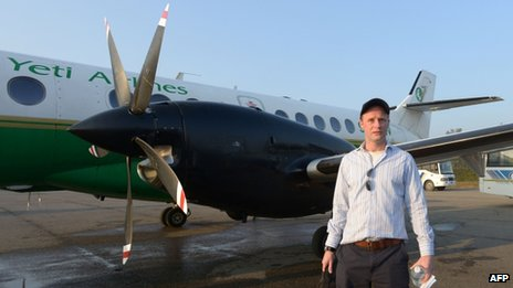 Charles Douglas-Hamilton, grandson of Douglas Douglas-Hamilton poses beside an aircraft before embarking on a trip to Mount Everest in Kathmandu on April 3, 2013,