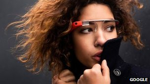 A woman models Google Glass