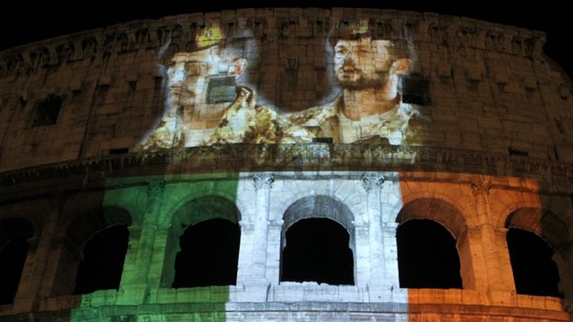 Pictures of Italian marines detained in India are projected together with the colours of the Italian flag on the Colosseum in Rome
