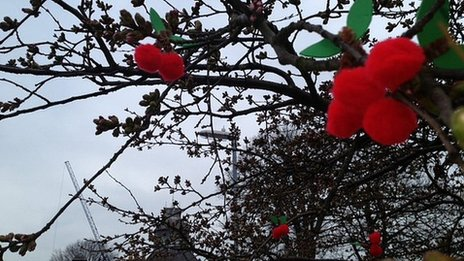 Knitted cherries on a tree