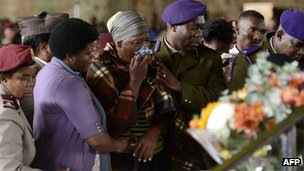 Relatives of the South African soldiers who died during a battle with rebels in the Central African Republic attend a memorial service at the Swartzkop Air Force Base in Pretoria on 2 April 2013
