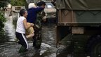 A soldier helps to evacuate an elderly woman in La Plata, 3 April 2013