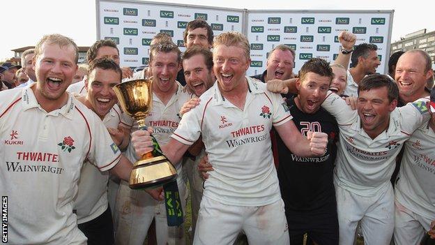 Glen Chapple celebrates Lancashire's Championship success of 2011