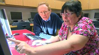 Man and woman search for online bargains