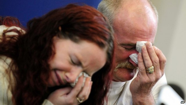 Mick and Mairead Philpott react during a news conference following a fire at their home
