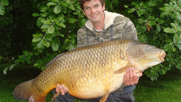 Benson the Carp and angler Tom Lindfield