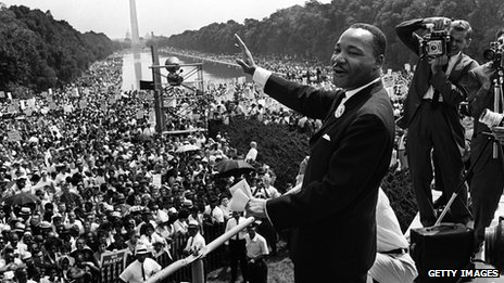 Civil rights leader Martin Luther King  waves to supporters on the Mall in Washington, DC 28 August 1963