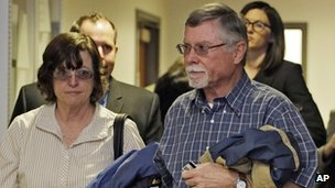 Arlene and James Holmes leave a hearing on 1 April