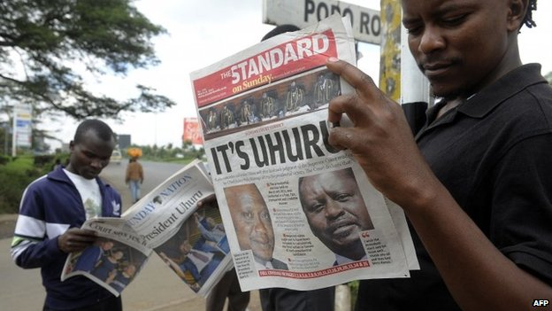 Nairobi resident read on 31 March 2013 in Nairobi the newspaper with the headline of Kenyan fourth president Uhuru Kenyatta's win, following the supreme court's decision that he was duly elected