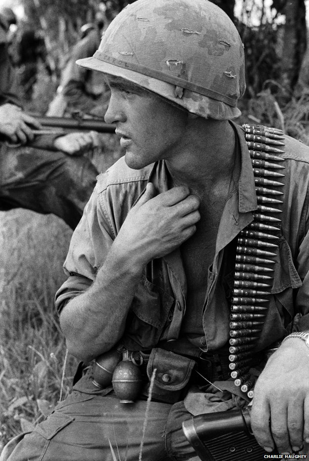 An M60 operator pauses for a moment under the heavy load of machine gun ammunition