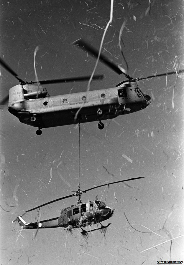 A Chinook rescues a downed Huey from a rice paddy near Trang Bang, January 1969