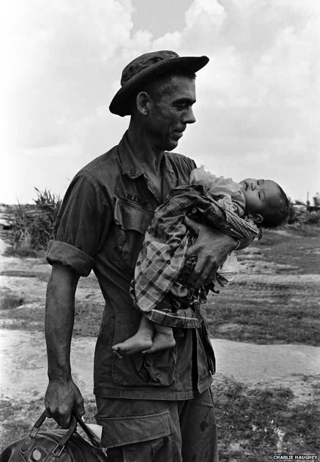 Staff Sergeant Edgar D Bledsoe, of Olive Branch, Illinois, cradles a critically ill Vietnamese infant