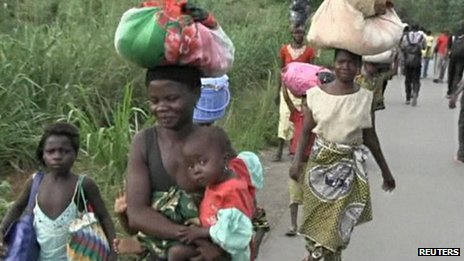 People walk as they leave Begoua for capital Bangui - 23 March 2013