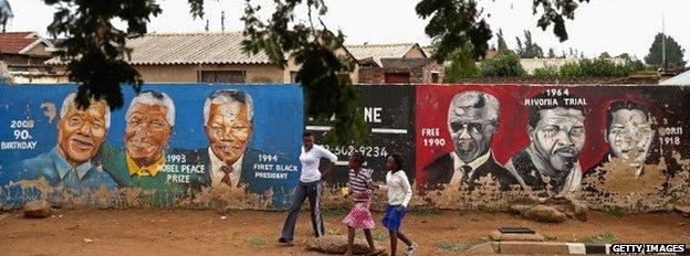 Graffiti showing the landmarks of Nelson Mandela's life