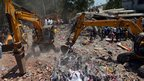 Excavators clear debris in Thane, Mumbai, on 5 April 2013
