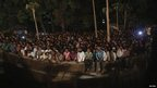 People watch the rescue effort in Thane, Mumbai, on 4 April 2013