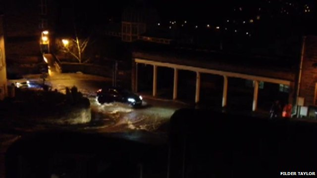 Cars passing through flood water in Matlock