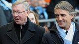 Manchester United manager Sir Alex Ferguson (left) and Manchester City counterpart Roberto Mancini