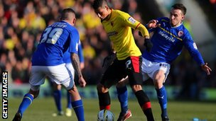Watford's Matthew Briggs (centre) is challenged by Cardiff's Daniel Pudil and Craig Bellamy