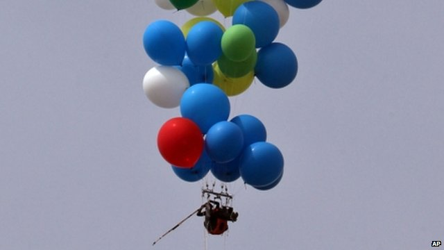 Man tied to balloons