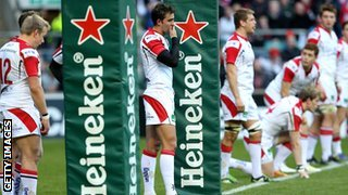 Ulster's players stand forlorn behind the posts after Chris Ashton's decisive try